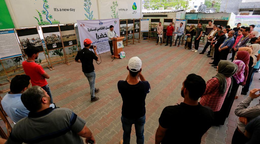 برعاية بيت الصحافة...فريق ديرنا الشبابي يختتم مبادرة 'خضرا' بمعرض صور
